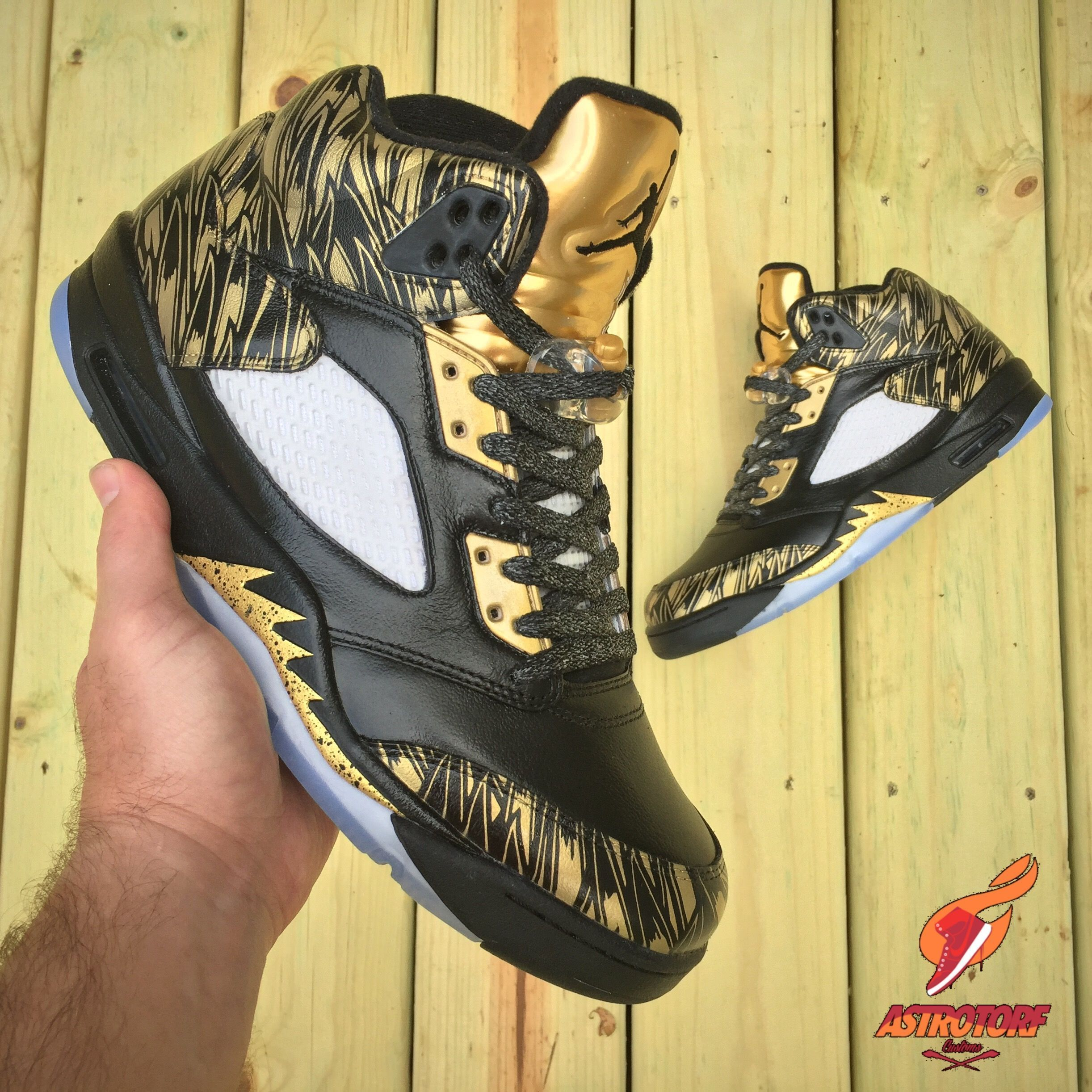 b4c25fc520e53b Astrotorf Customs Gives The Air Jordan 5 Olympic Some Golden Wings   cruiseoutfits