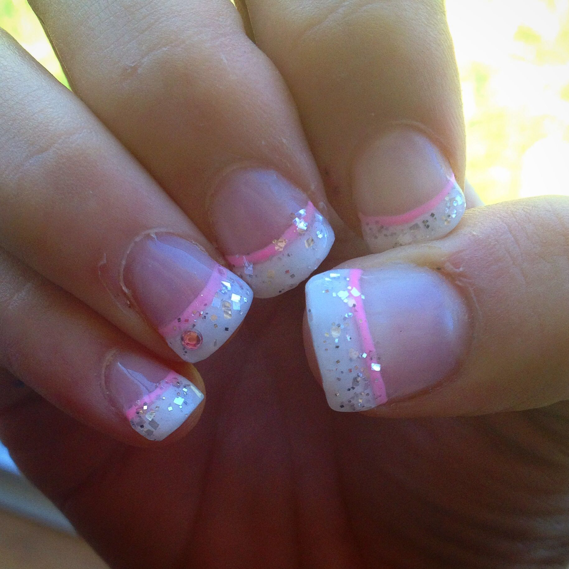 White French manicure with a twist, silver glitter, and a light baby ...