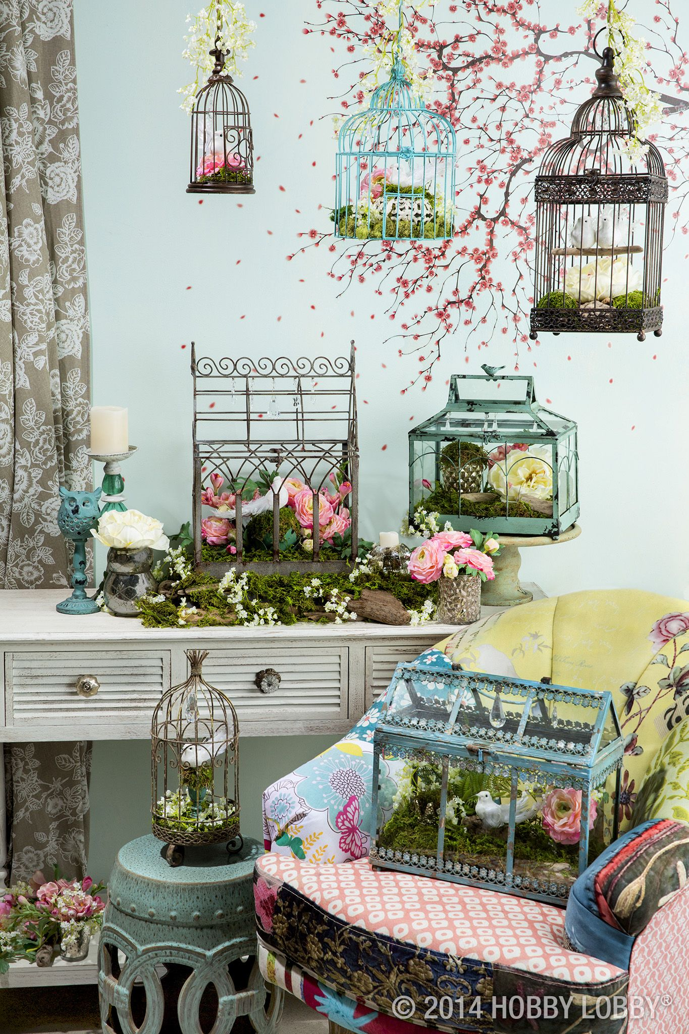 Hobby lobby garden decor  Beautiful birdcages and terrariums bring the magic of spring into