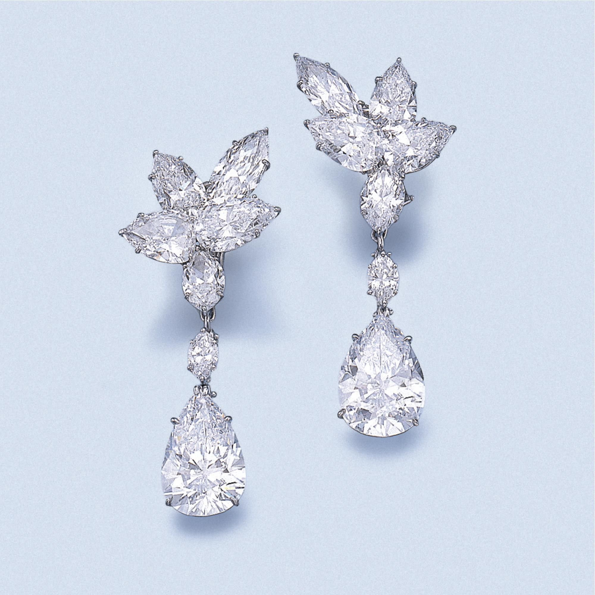 IMPORTANT PAIR OF DIAMOND PENDENT EARRINGS, HARRY WINSTON, CIRCA 1975. Each surmount designed as a cluster of pear- and marquise-shaped diamonds, two of the pear-shaped stones weighing respectively 2.24 and 2.76 carats, suspending a detachable pendant set with a marquise- and a pear-shaped diamond, the pear-shaped stones weighing respectively 8.43 and 8.91 carats, mounted in platinum, unsigned, maker's marks for Jacques Timey.