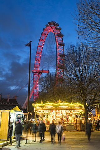 Christmas Market in Jubilee Gardens, with The London Eye at night, South Bank, London, England, United Kingdom, Europe