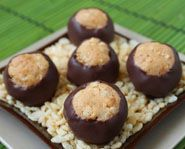 Crunchy Buckeyes take the familiar buckeyes candy recipe and add a fun, easy twist: crisped rice cereal. The resulting nutty candy has a light texture and a satisfying crunch, all enveloped in a layer of chocolate.