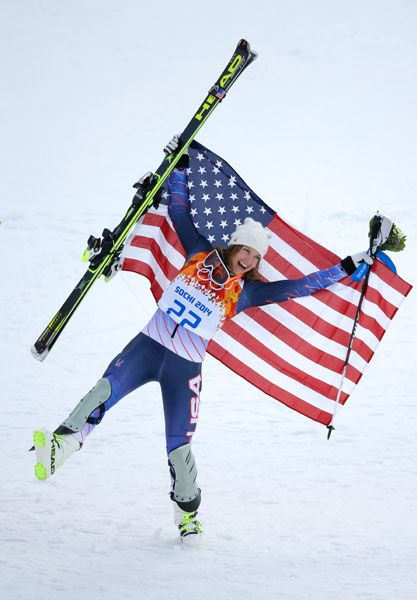 SOCHI, RUSSIA - FEBRUARY 10: Bronze medalist Julia Mancuso of the United States celebrates after the flower ceremony for the Alpine Skiing Women's Super Combined on day 3 of the Sochi 2014 Winter Olympics at Rosa Khutor Alpine Center on February 10, 2014 in Sochi, Russia. (Photo by Ezra Shaw/Getty Images)