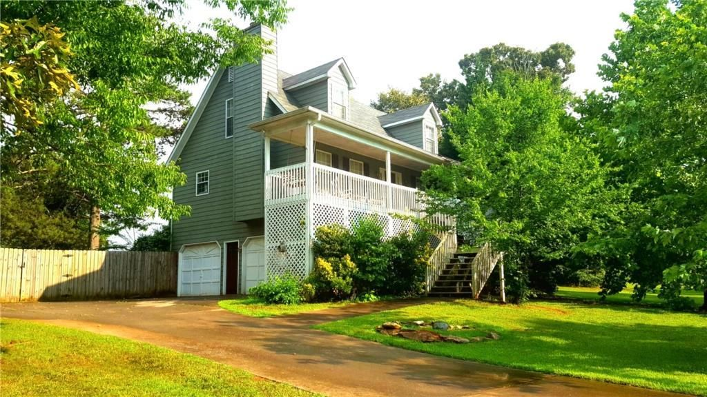 Best Cape Cod Style W A Covered Front Porch Situated On A 400 x 300