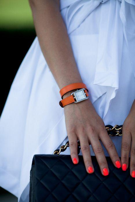 LOVE the orange nails and watch against white/black wardrobe. Via ...