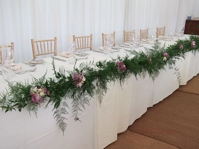 Table Garland We Did Using Asparagus Fern And Vintage Pink Roses This Is Pinned Along The Edge But You Wedding Table Garland Head Table Wedding Wedding Table
