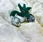 Ravelry: Crochet Dragon Eggs with Baby Dragon pattern by Christine Nast