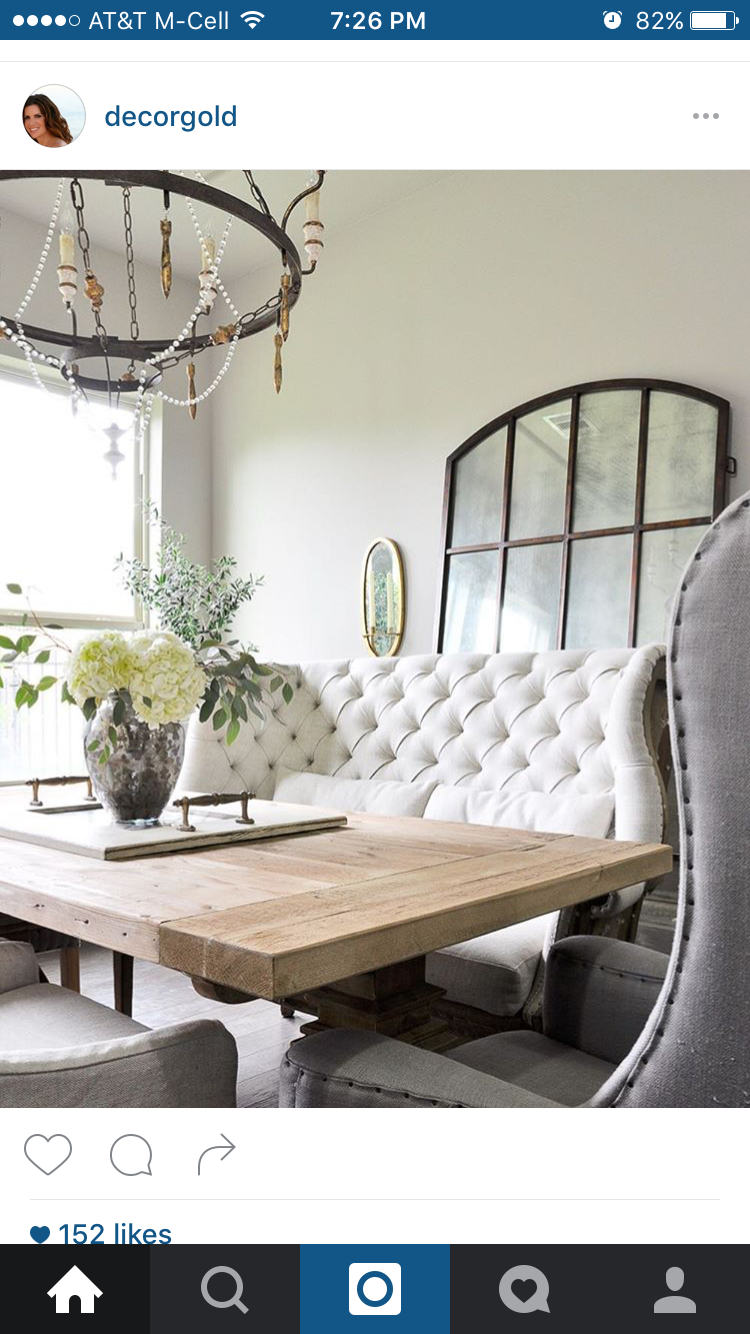Neutral Dining Room With Tufted Settee And Leaning Mirror