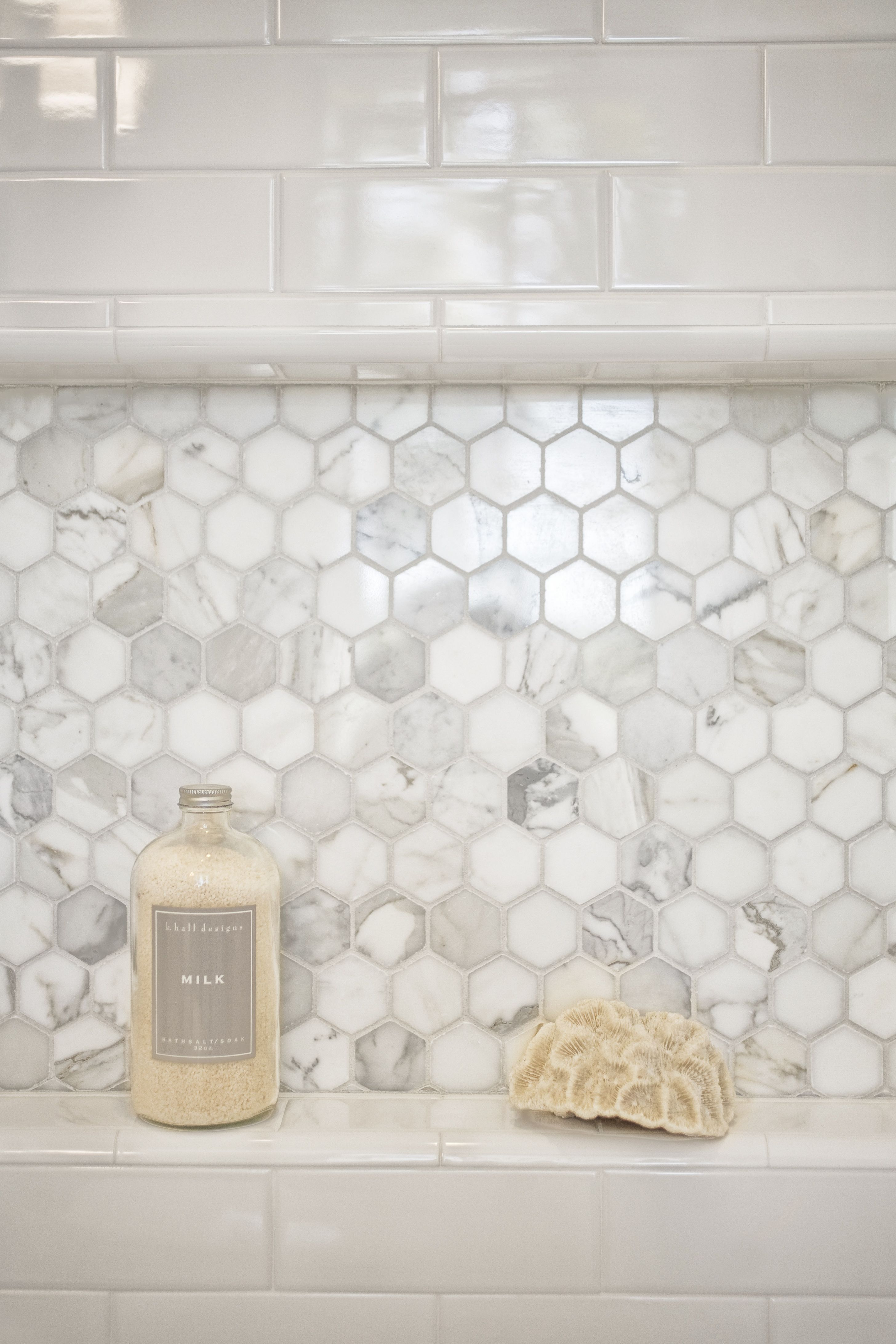 Mill valley estate bathroom shower niche tile is calacatta in this bathroom youre mixing plain white subway tiles with marble mosaic pieces it definitely makes the shower area shine and with just a hint of color dailygadgetfo Images