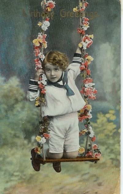 Vintage birthday card with a boy in sailor suit on a swing with flowers