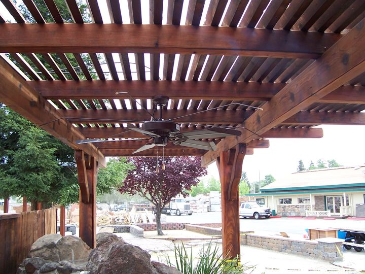 Dark Wood Finish Lattice Patio Cover With Ceiling Fan In