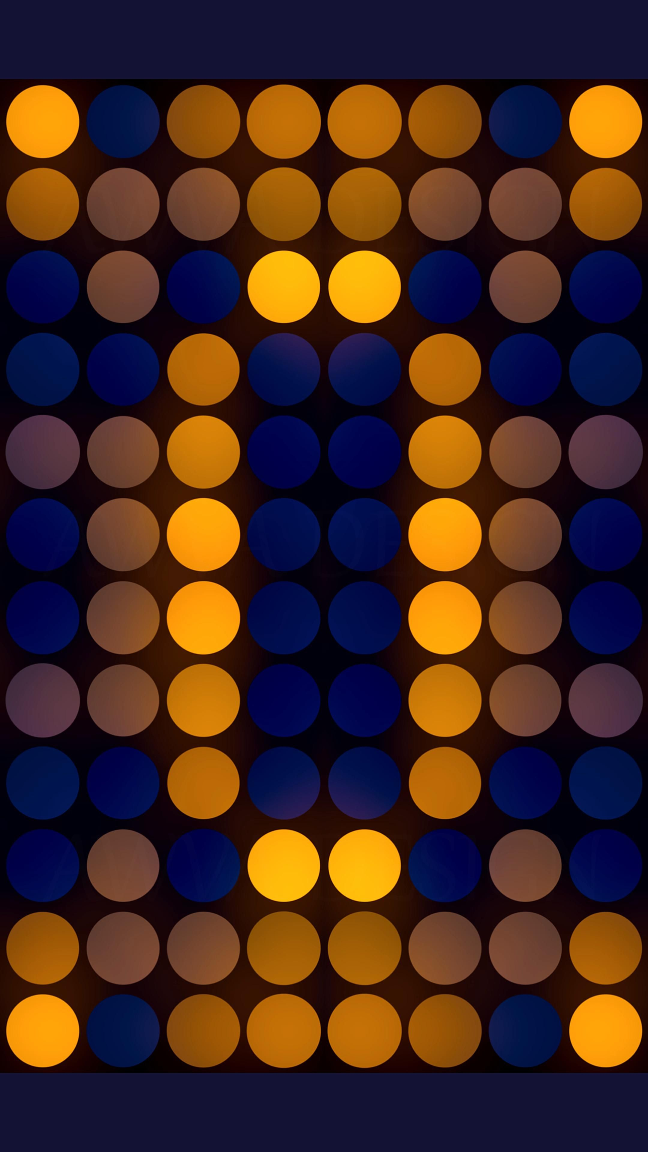 The bright purple-yellow mosaic of circles on a dark blue background.