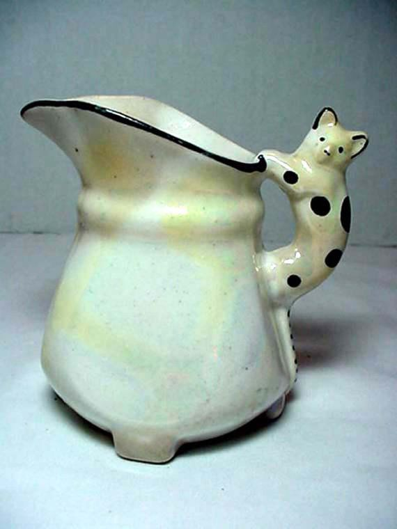 For over 2000 Vintage & Antique Items please visit us at:    http://www.dixieantiques.net    Czechslovakian Creamer with Cat from the 1930s.    It