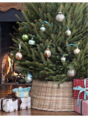 5 new ways to deck the halls the new tree skirt so long standard base hiding apron this kicky wicker mini provides contemporary cover with natural style - Mini Christmas Tree Skirt