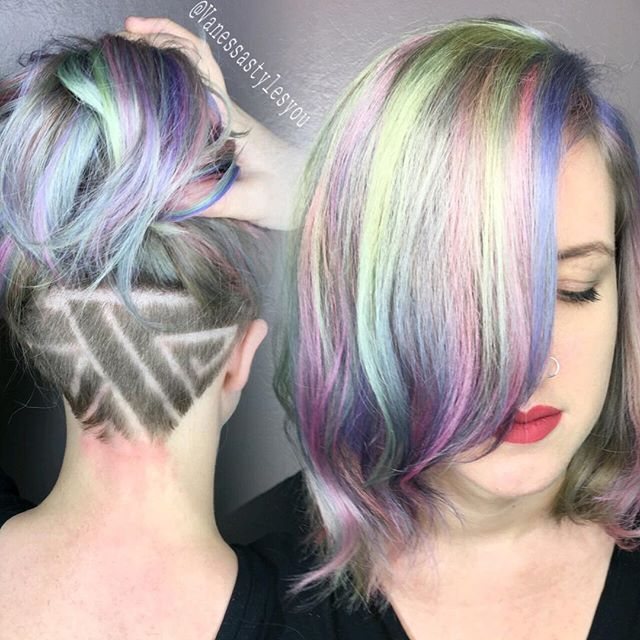 Pastel rainbow hair color with undercut carving by