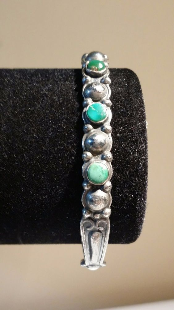 A gorgeous handmade early Navajo piece featuring a beaded silver stamping which alternates with turquoise stones that are round in shape and vary in color but are a forest green. The cuff is quite small but has a nice solid feel and weighs about 12 grams. | eBay!