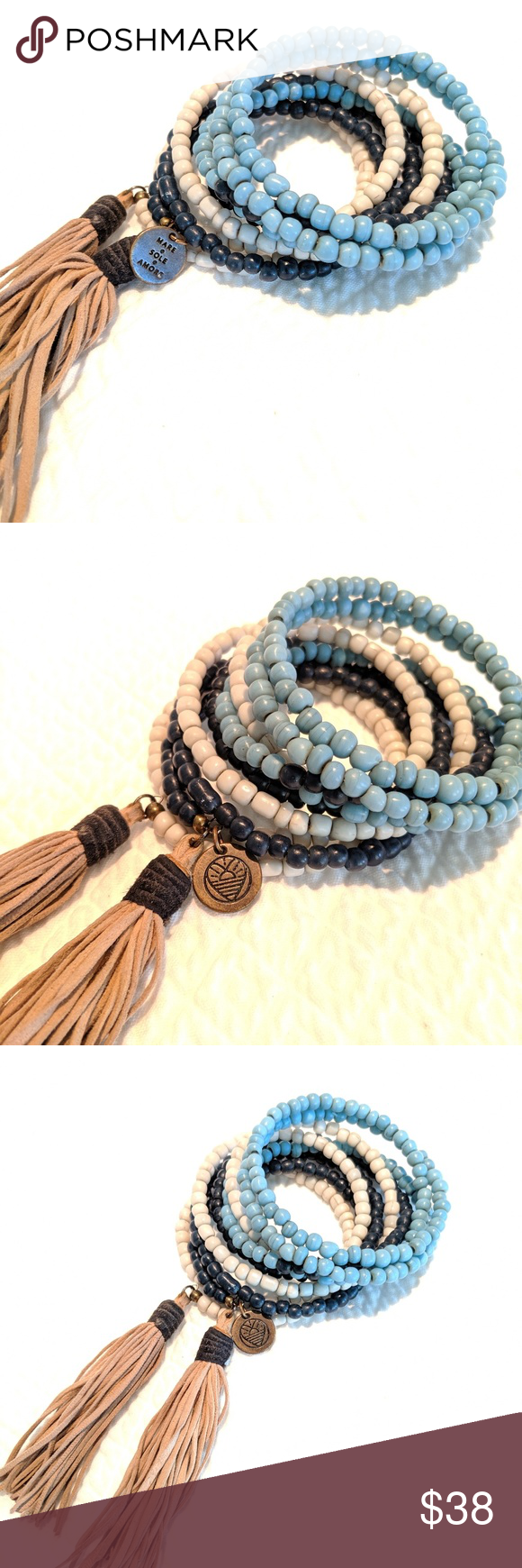 Wrap tassel bracelet from Mare.Sol.Amore Wrap bracelet with suede tassels. Beaded on wire to wrap your wrist. Navy, turquoise and gray with taupe tassels. Perfect with Muche et Muchette caftan dress. Mare. Sol. Amore. Jewelry Bracelets