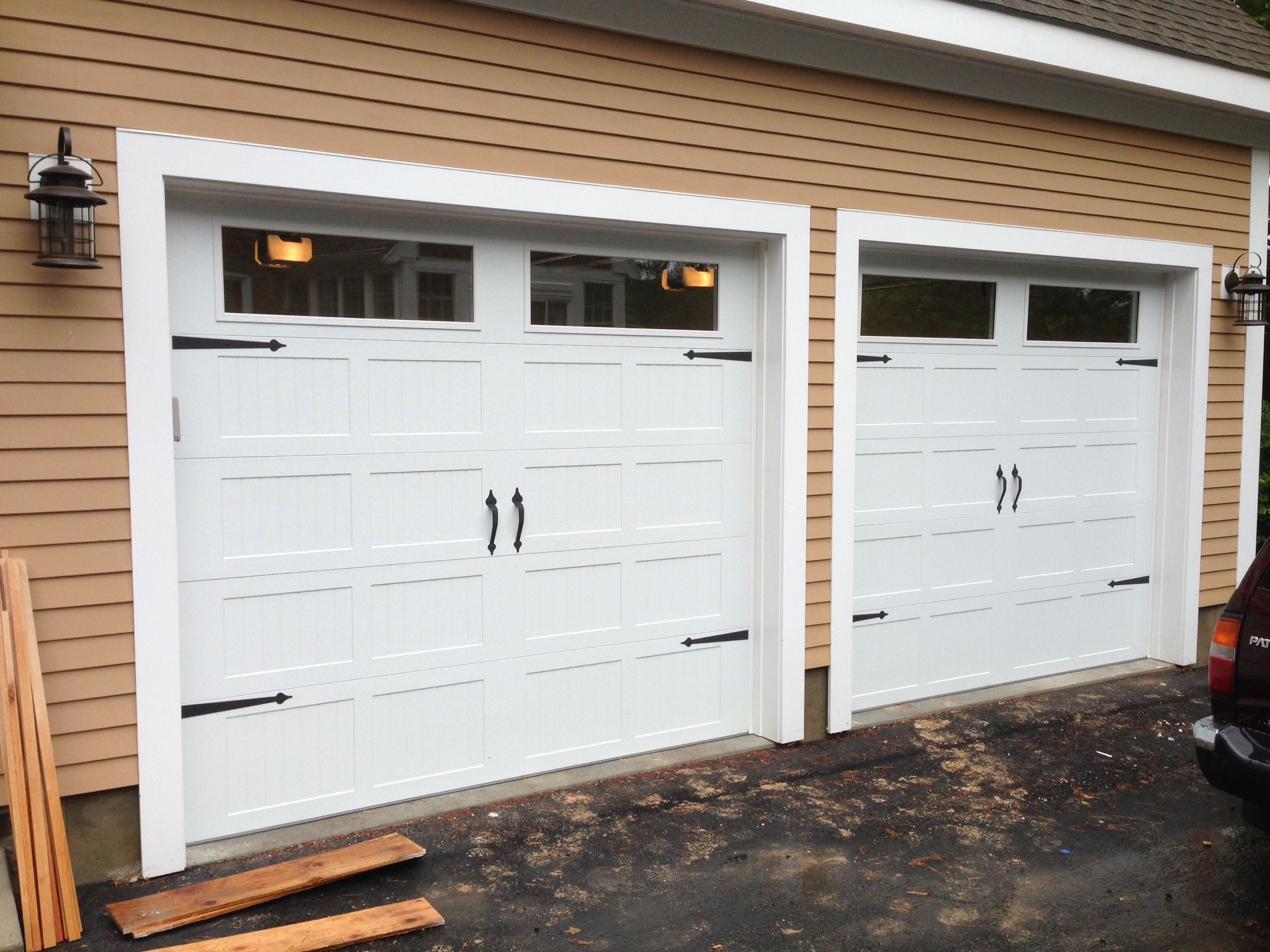 @C.H.I. Overhead Doors Model 5216 Steel Carriage House Style Garage Doors  In White With Plain