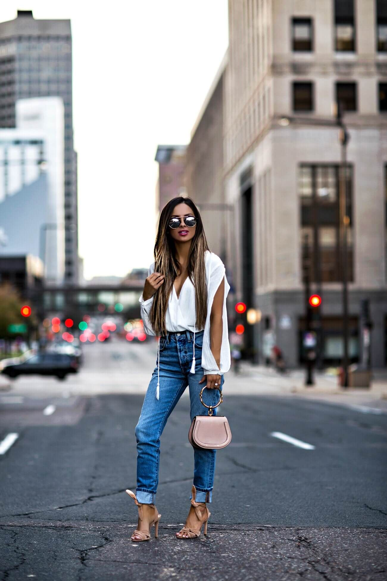 7fae24bf8667 fashion blogger mia mia mine wearing a white long-sleeve bodysuit from  revolve and schutz monia heels
