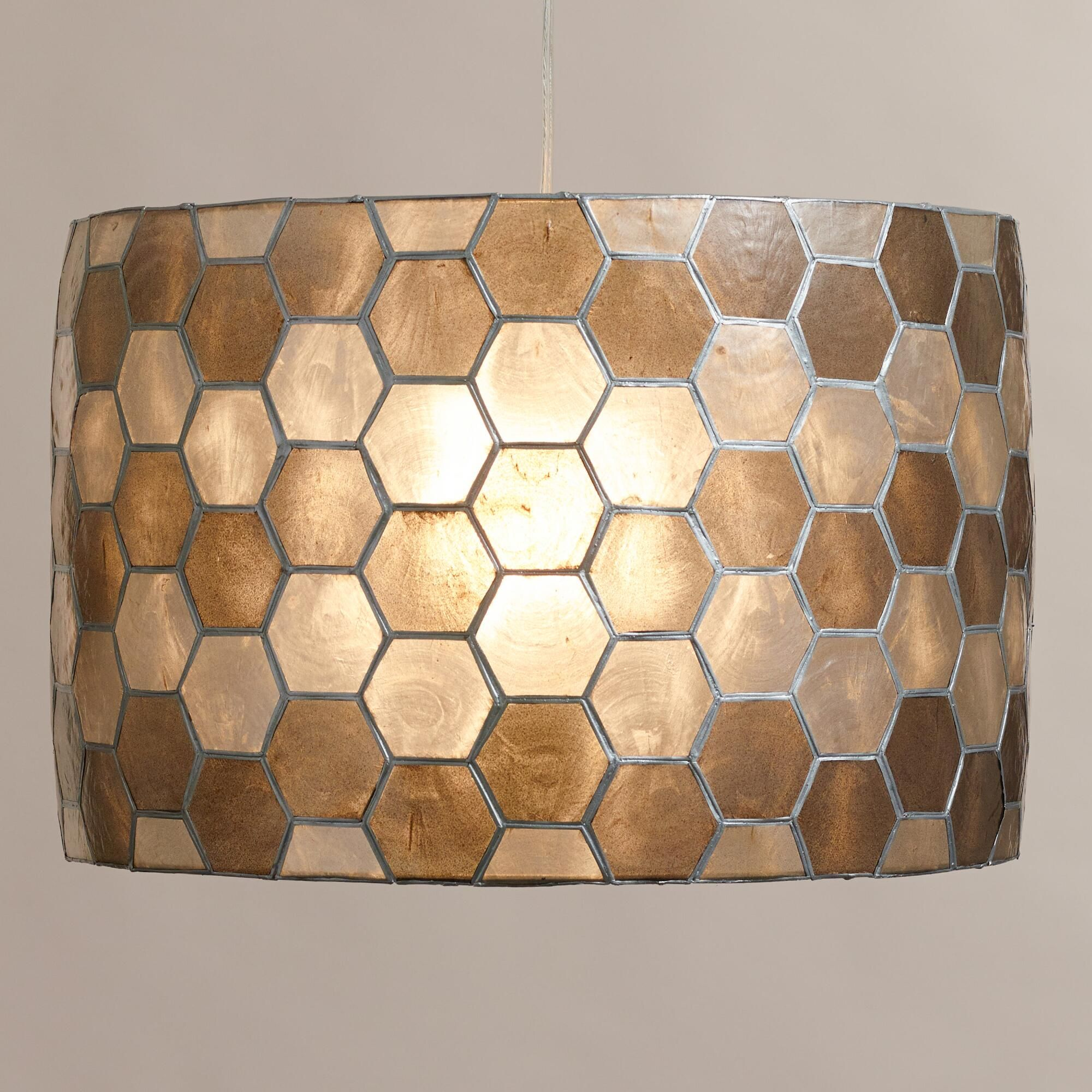 Handcrafted of naturally harvested capiz shells cut and assembled into a honeycomb design by artisans in the Philippines, our exclusive drum pendant is a striking work of art perfect for the living, dining or bedroom.