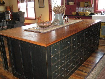 Primitive Kitchen Islands red cabinets with soapstone counters, black island with butcher