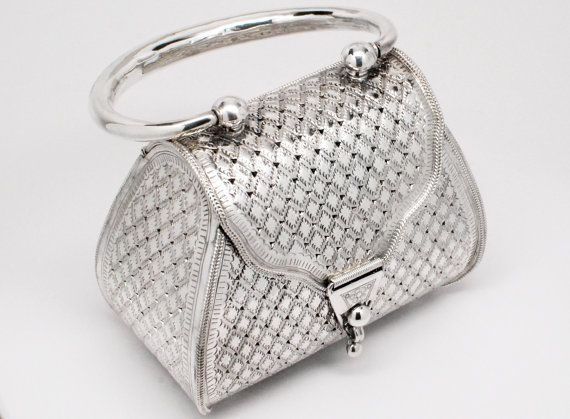 """Vintage Sterling Silver Purse Hand Bag.  Beautiful vintage 925 Sterling Silver Hand Bag / Purse! This stunning little purse is hand-crafted completely out of sterling silver with a gorgeous and intricate engraved floral pattern on the handle. The rest of the purse has a diamond shape pattern with a shiny high polish finish. This purse hinged and is fully functional! This item has a weight of 326.26 grams, a total length(including handle) of 7"""" and the base measures 5"""" across. Very nice…"""