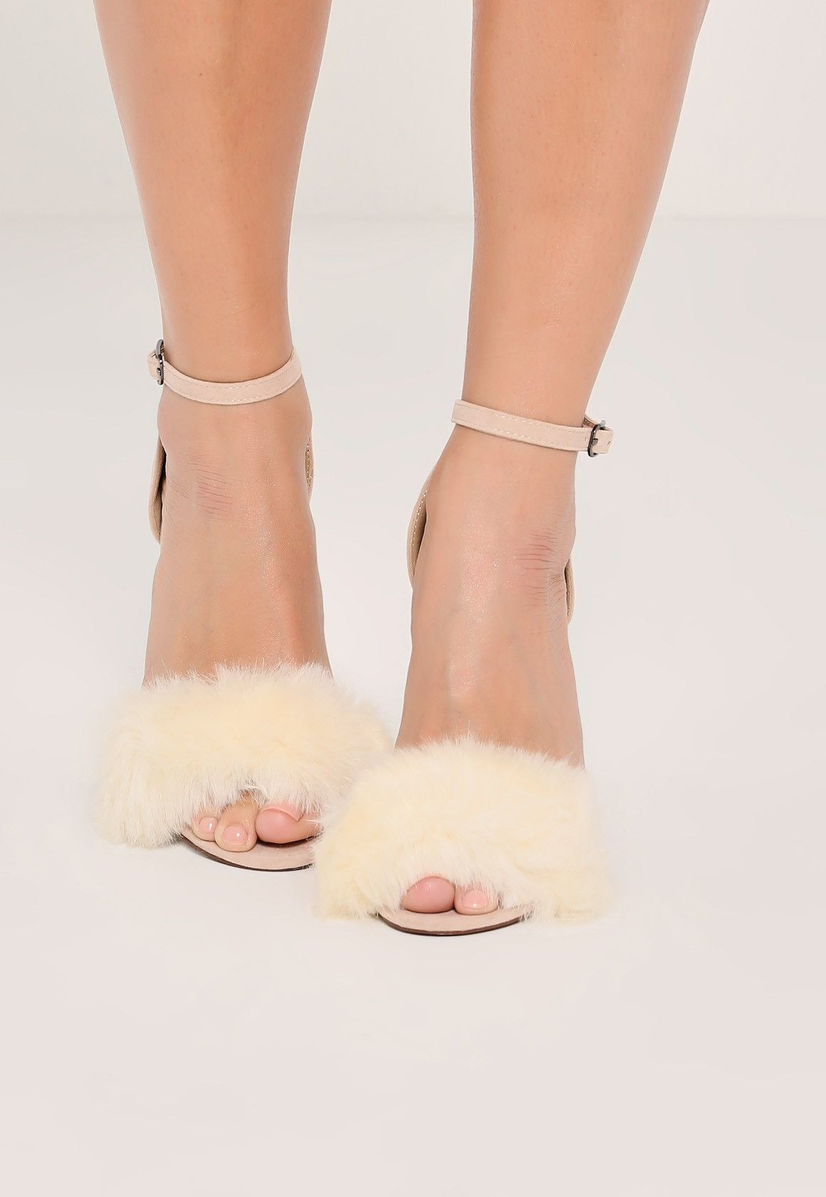 Fluffy heels give us the ultimate luxe feelin' and these nude vamp strap barely there heels are top of our wish list.