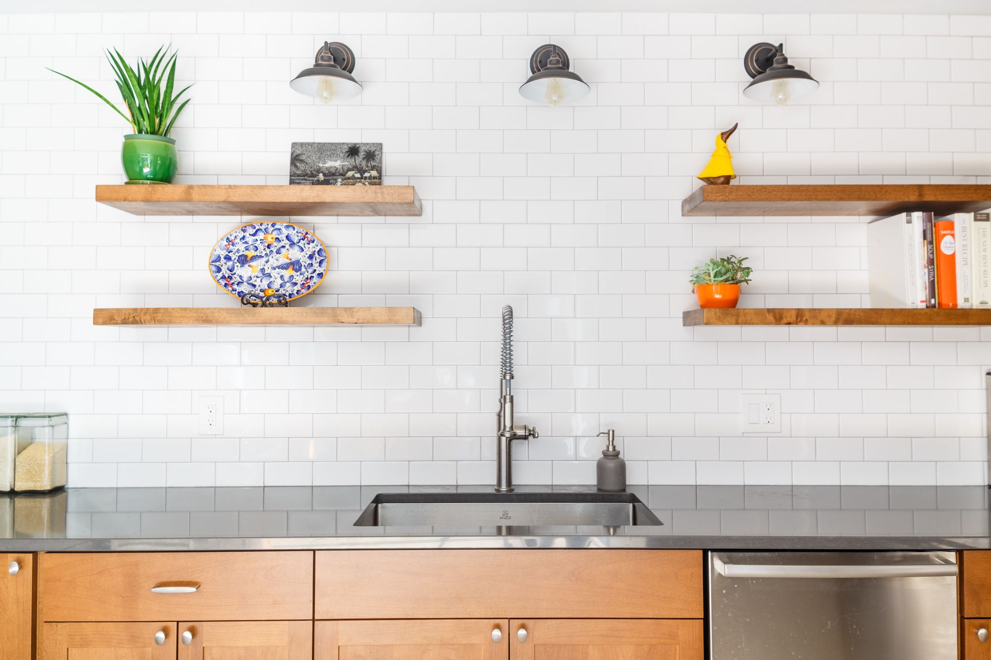 White tile and stained woodgrain cabinets, a modern ...