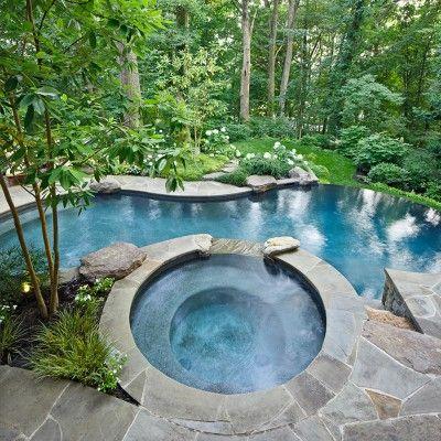 Vanishing edge swimming pool w flagstone patio walls in for Pool design northern virginia
