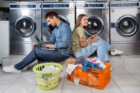 Stock Photo Coin Laundry Listening To Music Commercial Laundry