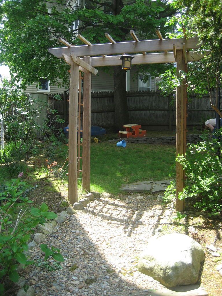 Build a wooden garden arbor arbors garden arbours and for Timber garden arch designs