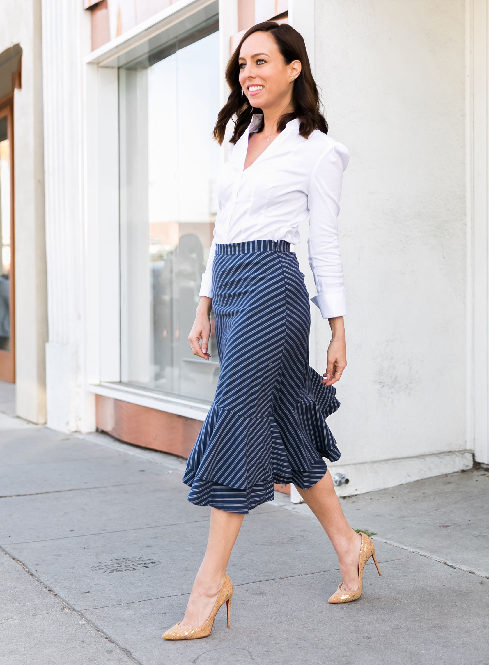 8a09162ecad1 Sydne Style shows what to wear to the office in white button down shirt and  pinstripe pencil skirt #stripe #skirts #prints #ruffles #louboutin