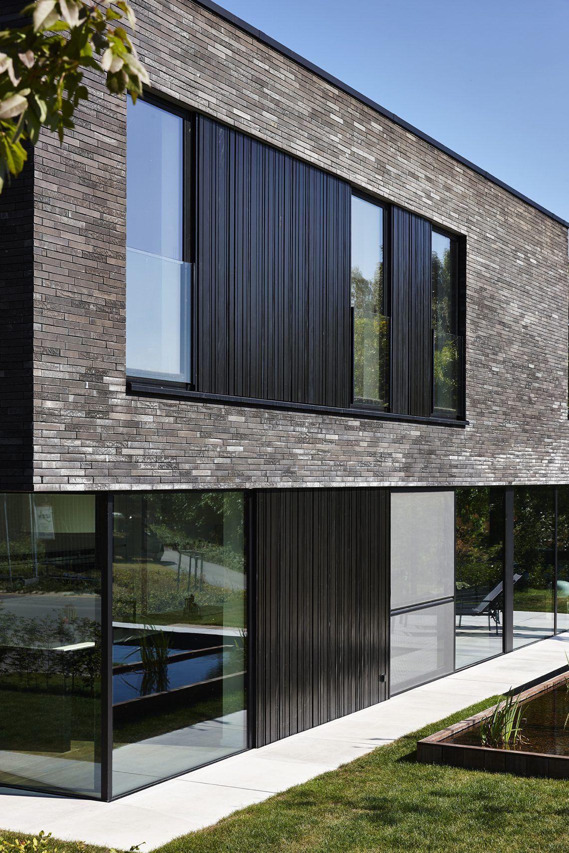 Dumobil villabouw strakke villa met grijze gevelsteen for Moderne villabouw