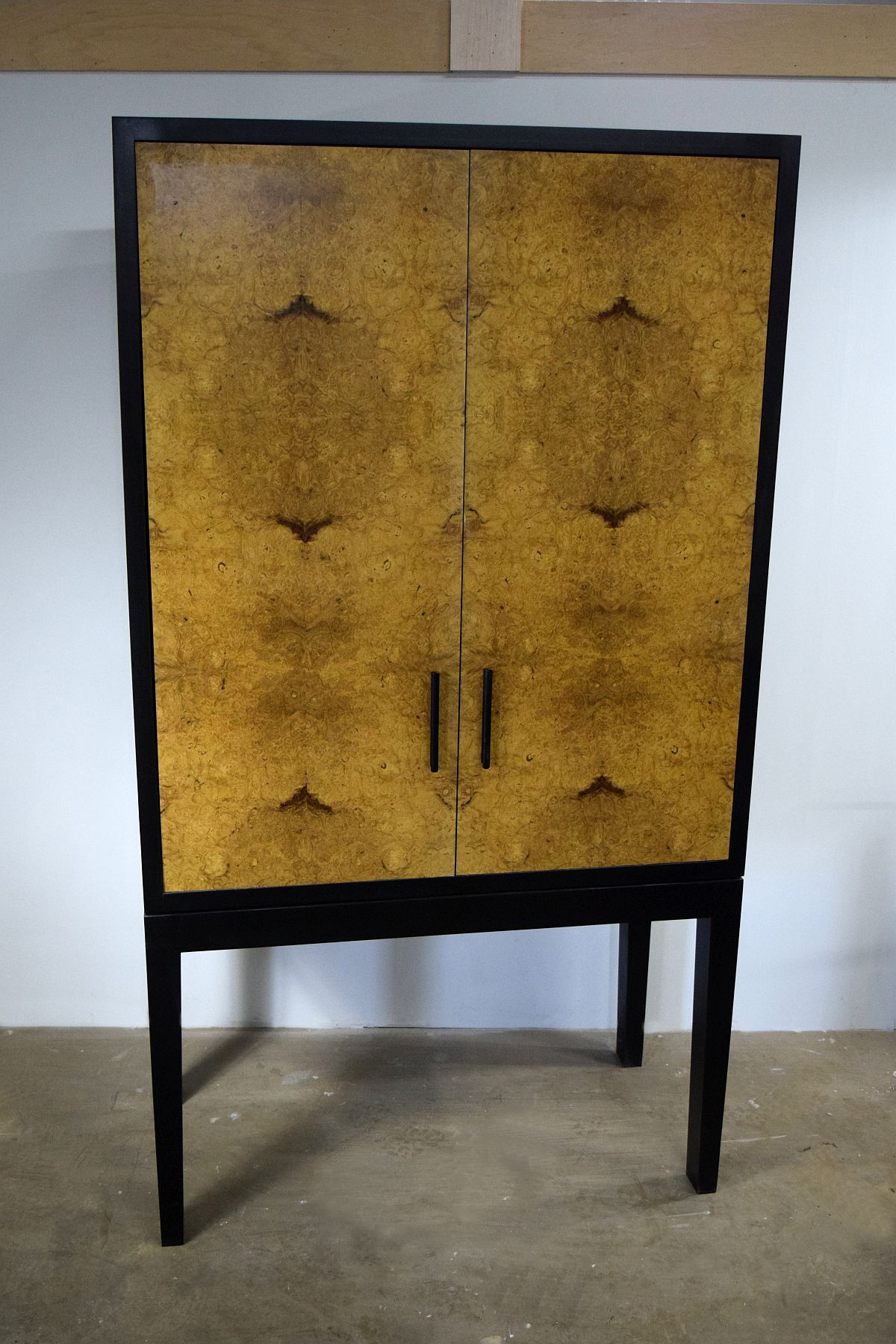 Modern television cabinet made from maple with burl veneered