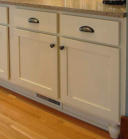 Simple partial overlay cabinets. Dura Supremeu0027s Santa Fe door style shown  in Antique White/