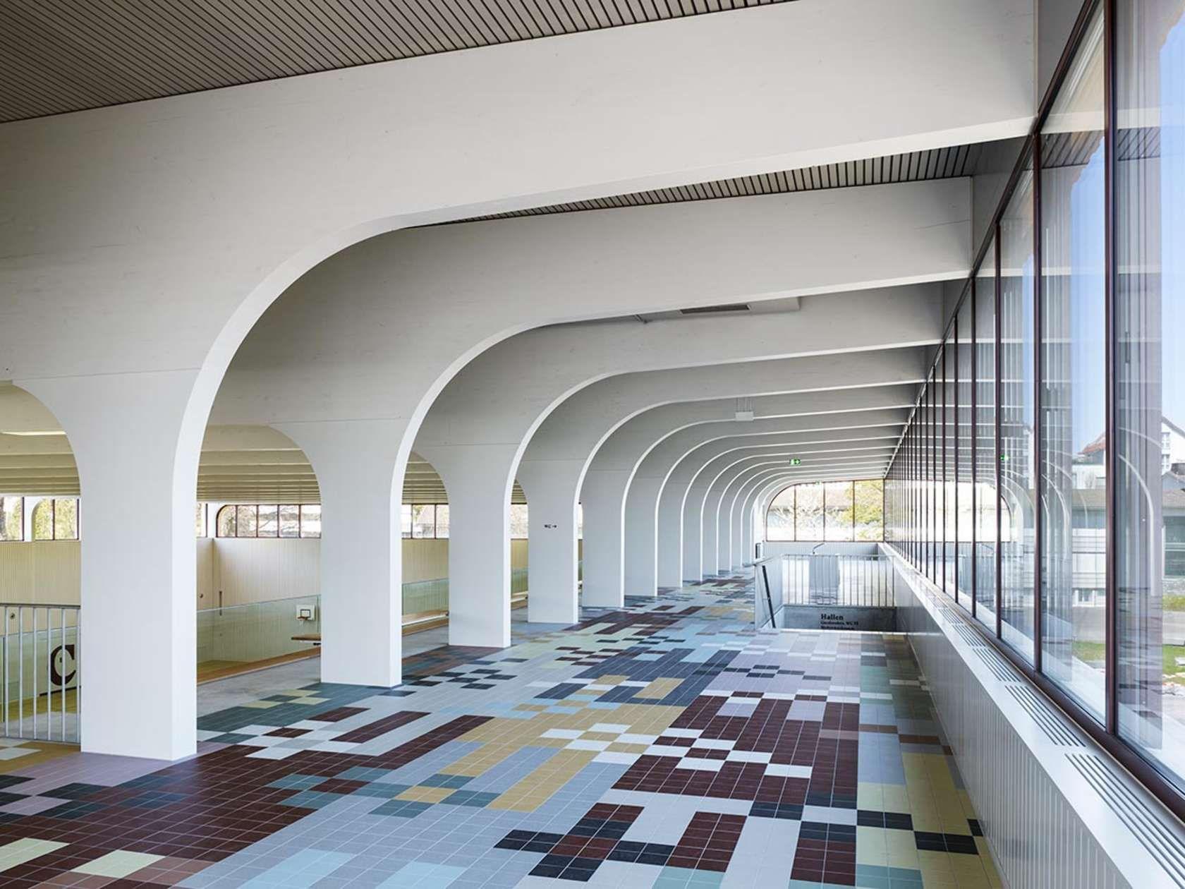 Firm pool architekten project multipurpose hall for Pool design school