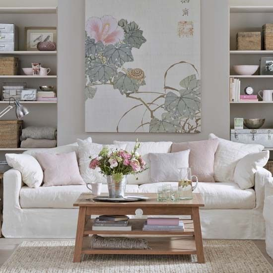 picturesque tropical inspired living rooms. Pink and white traditional livingroom with beautiful painting  comfortable sofa design