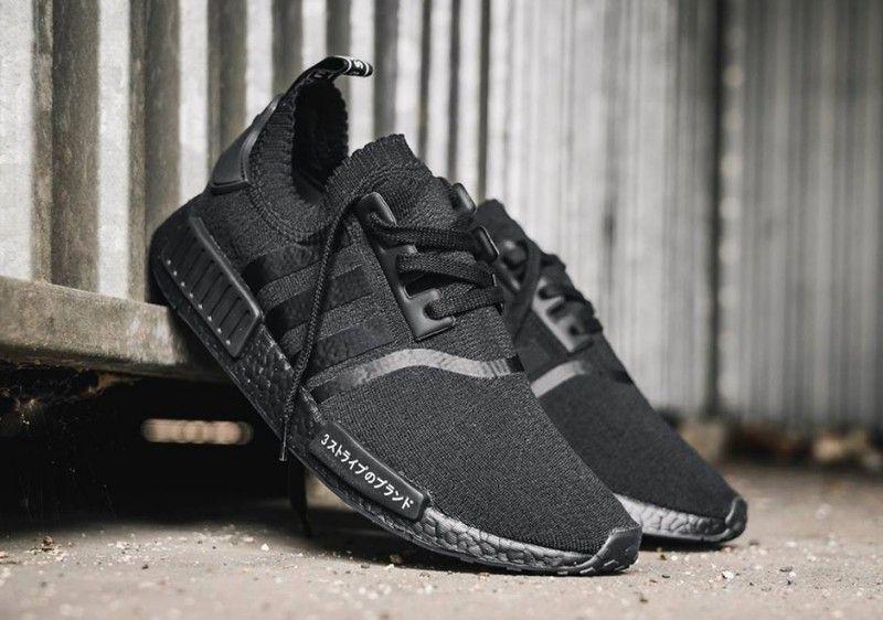 the adidas nmd triple black