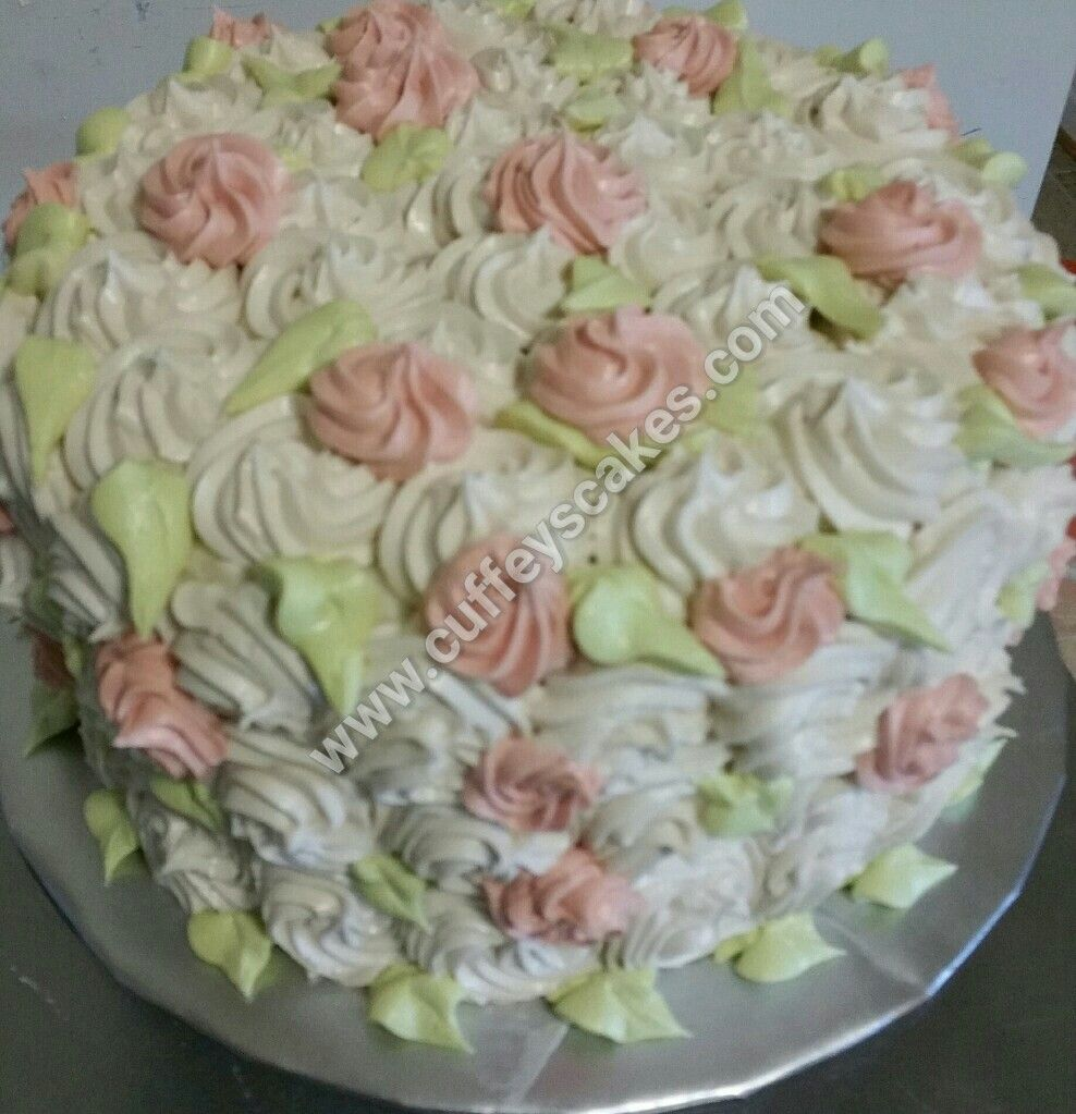 This gurl is called Sonia! Shes a gurly gurl. Just a hint of flirty pink...Vanilla Bean butter cake, white chocolate mousse, Grand Marnier strawberries inside, swiss meringue butter cream on the out.  #swissmeringuebuttercream #flowers #flowercake #rosettecake #pink #kardashian #pinkandgreen #green #cake #cuffeyscakes