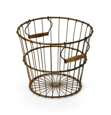 """Rustic Farmhouse Egg Basket-Add more functionality to your living, patio or garden area with our fantastic Rustic Iron Egg Basket. This basket is exquisitely designed with quality iron material and completed with rustic finish to add an hip vintage charm to your farmhouse. It can serve you with numerous purposes and is provided with stylish handles on either sides to avail ease of portability.Rustic Farmhouse Egg Basket measures 11"""" H x 13"""" Diameter"""