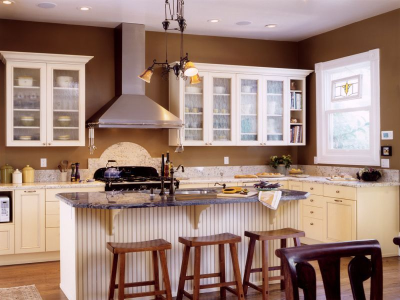 white kitchen cabinets brown walls
