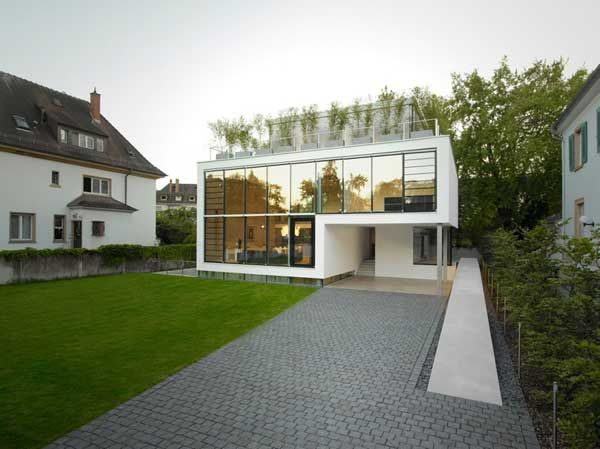 modern house with glass walls and rooftop terrace house r design by