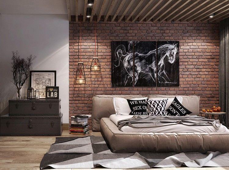 rote Ziegelwand und beigefarbenes Polsterbett im Schlafzimmer - wandgestaltung ideen schlafzimmer