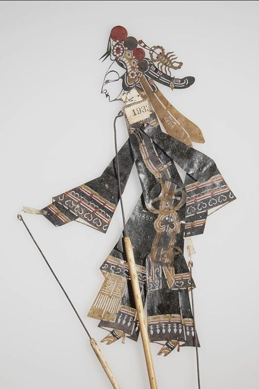 SHADOW PUPPET, BODY, WOMAN'S DRESS  ASIAN ETHNOGRAPHIC COLLECTION  Catalog No: 70 /10355 Field No: 1933   Culture: CHINESE  Country: CHINA  Material: HIDE, PIGMENT, BAMBOO, METAL, THREAD  Dimensions: BODY) L:21.5 W:21 H:.3 WITH ROD) L:30 D:.6 [in CM]  Acquisition Year: 1903 (EXPEDITION)   Donor: LAUFER, BERTHOLD