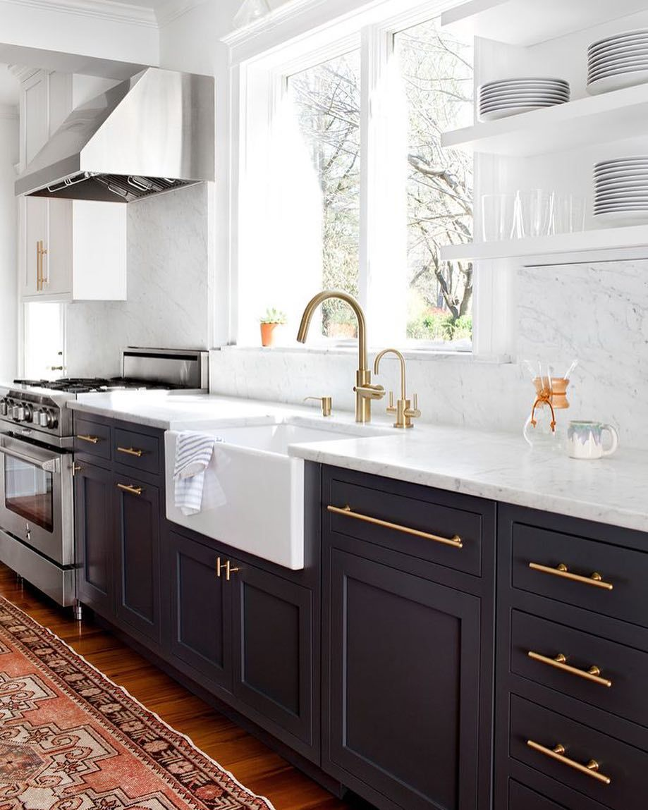 Two toned cabinets, white upper/black lower and medium floors ...