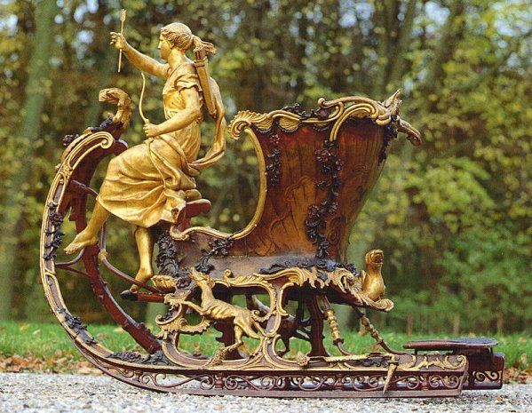 This sled was originally the property in 1760 of King William 1st. It is decorated by a sculpture of Diana, goddess of the hunt. She is accompanied by dogs on the sill. The set is painted in gold and polychrome. The interior is trimmed in yellow and red velvet Florentine    One of the coolest winter decorations ive ever seen.