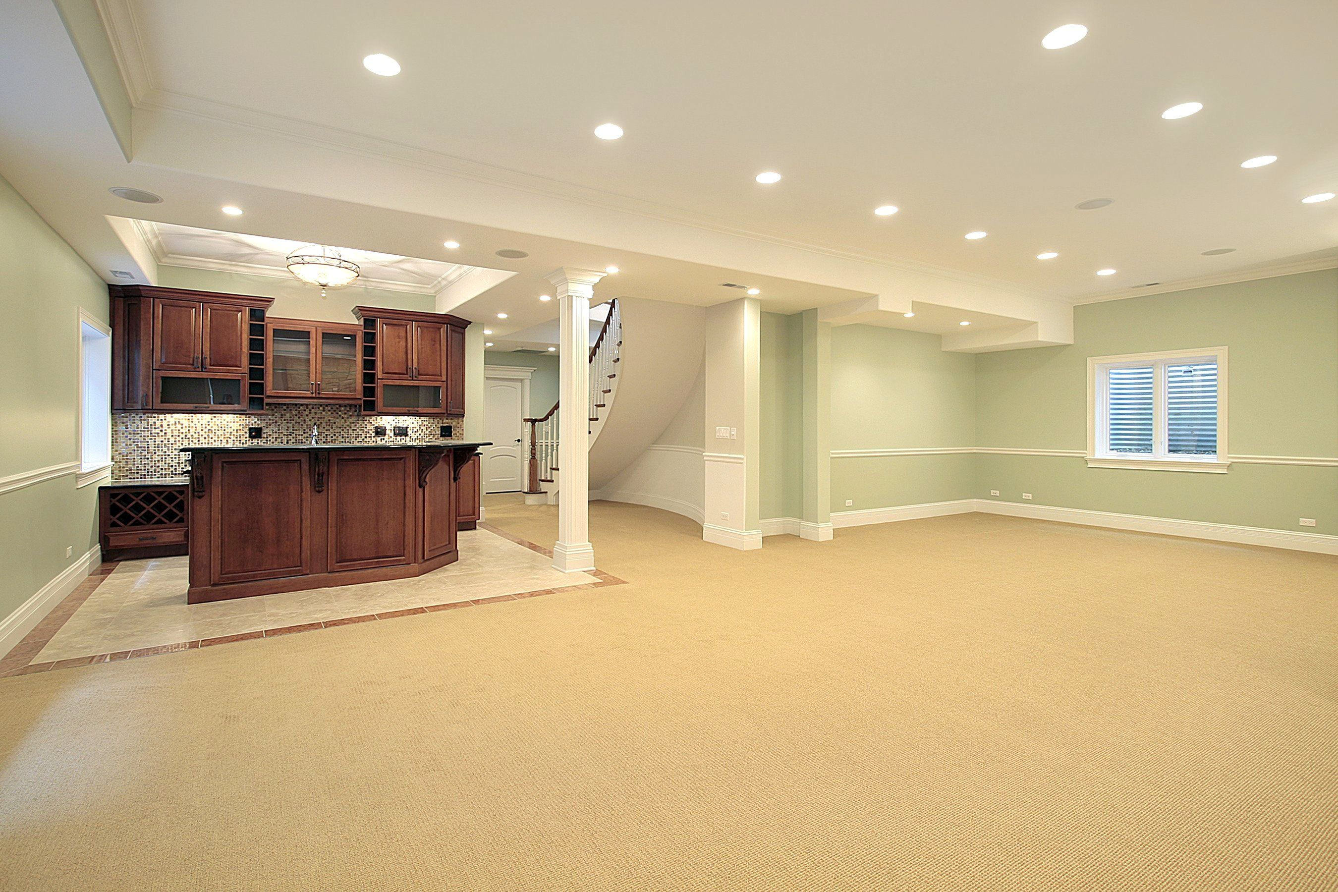Adorable spacious basement remodeling with soft green wall for Cheap wall to wall carpet