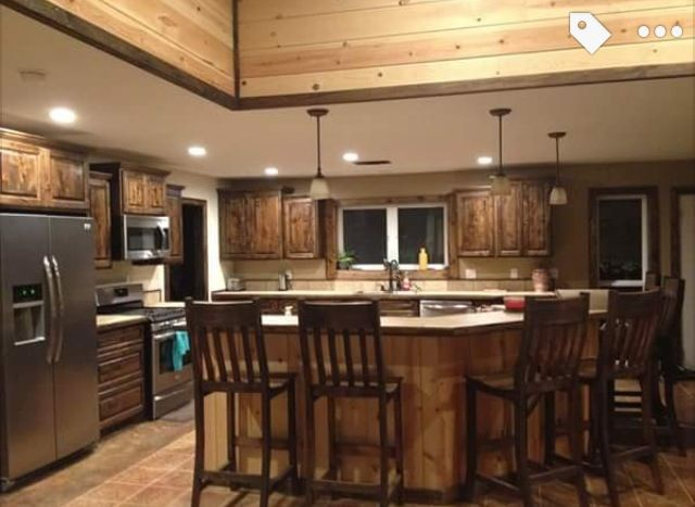 Knotty alder cabinets with Jacobean stain and stainless ...