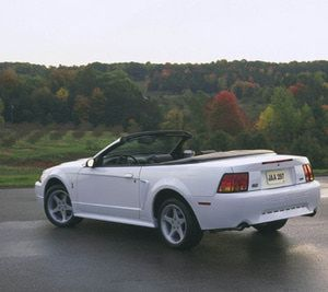1999 Ford Mustang SVT Cobra The redesigned Mustang, which coincided with the 35th anniversary of the Mustang, featured sharp design lines and an aggressive stance in addition to a new grille, hood, and lamps. Both engines received power upgrades. The 3.8L V-6 increased in horsepower to 190 hp, while the 4.6L DOHC V-8 was capable of producing 320 hp.