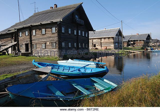 Lake Onega Russia; wooden houses on the shore and woodenboats in the fishing village